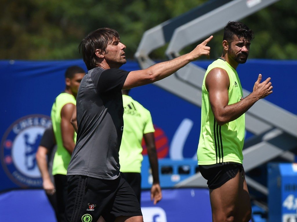 New Chelsea coach Antonio Conte (L) and striker Diego Costa (R) during a training session before their International Champions Cup (ICC) game against Liverpool, at the UCLA Campus in Westwood, California on July 26, 2016. The two teams will meet at the Rose Bowl on July 27, 2016. / AFP / Mark Ralston (Photo credit should read MARK RALSTON/AFP/Getty Images)