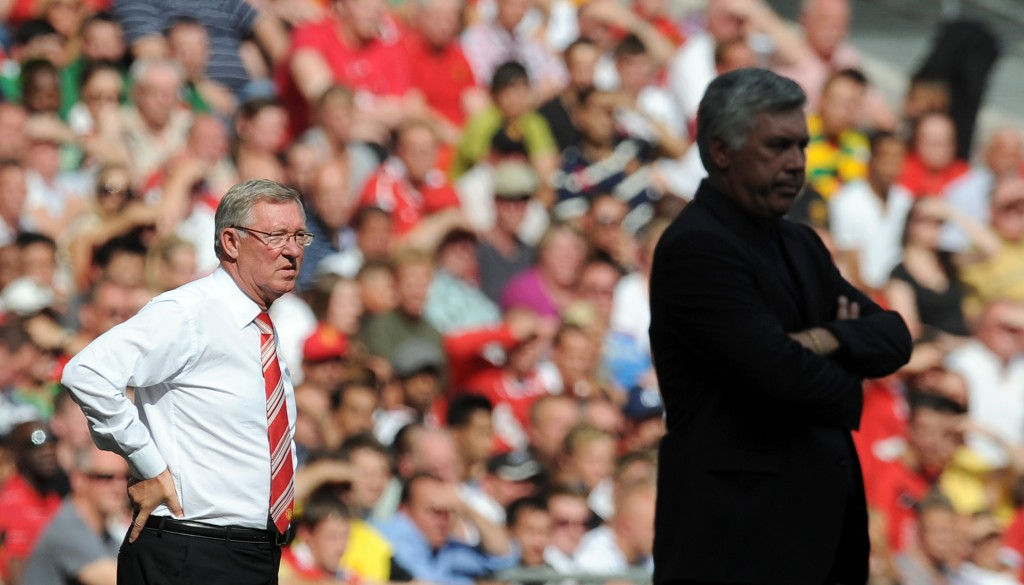 Manchester United's Manager Sir Alex Ferguson (L) looks on from the touchline from behind Chelsea's Manager Carlo Ancelotti (R) during the FA Community Shield football match at Wembley Stadium in London on August 8, 2010. Manchester United won the game 3-1. AFP PHOTO / ADRIAN DENNIS RESTRICTED FOR EDITORIAL USE/NO COMMERCIAL USE (Photo credit should read ADRIAN DENNIS/AFP/Getty Images)