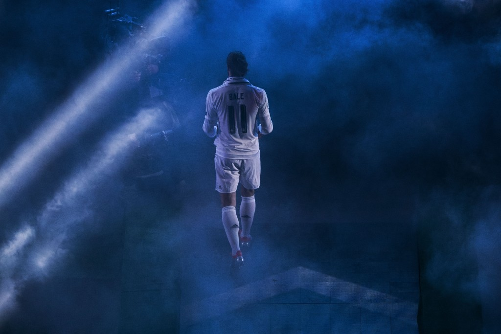 MADRID, SPAIN - MAY 29: Gareth Bale of Real Madrid CF enters the pitch during Real Madrid CF team celebration at Santiago Bernabeu Stadium the day after winning the UEFA Champions League Final match against Club Atletico de Madrid on May 29, 2016 in Madrid, Spain. Real Madrid CF is the only European football team with 11 European Cups (Photo by Gonzalo Arroyo Moreno/Getty Images)