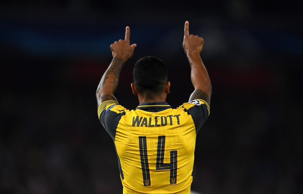LONDON, ENGLAND - SEPTEMBER 28: Theo Walcott of Arsenal ceclebrates after scoring the opening goal during the UEFA Champions League group A match between Arsenal FC and FC Basel 1893 at the Emirates Stadium on September 28, 2016 in London, England. (Photo by Mike Hewitt/Getty Images)