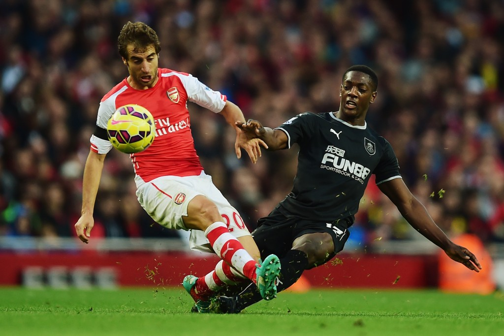 LONDON, ENGLAND - NOVEMBER 01: Mathieu Flamini of Arsenal is tackeld by Marvin Sordell of Burnley during the Barclays Premier League match between Arsenal and Burnley at Emirates Stadium on November 1, 2014 in London, England. (Photo by Jamie McDonald/Getty Images)