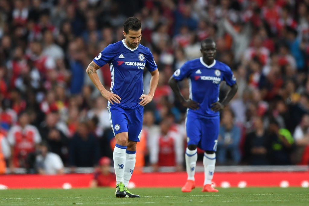 LONDON, ENGLAND - SEPTEMBER 24: Cesc Fabregas of Chelsea (L) show dejection after Arsenal score during the Premier League match between Arsenal and Chelsea at the Emirates Stadium on September 24, 2016 in London, England. (Photo by Shaun Botterill/Getty Images)