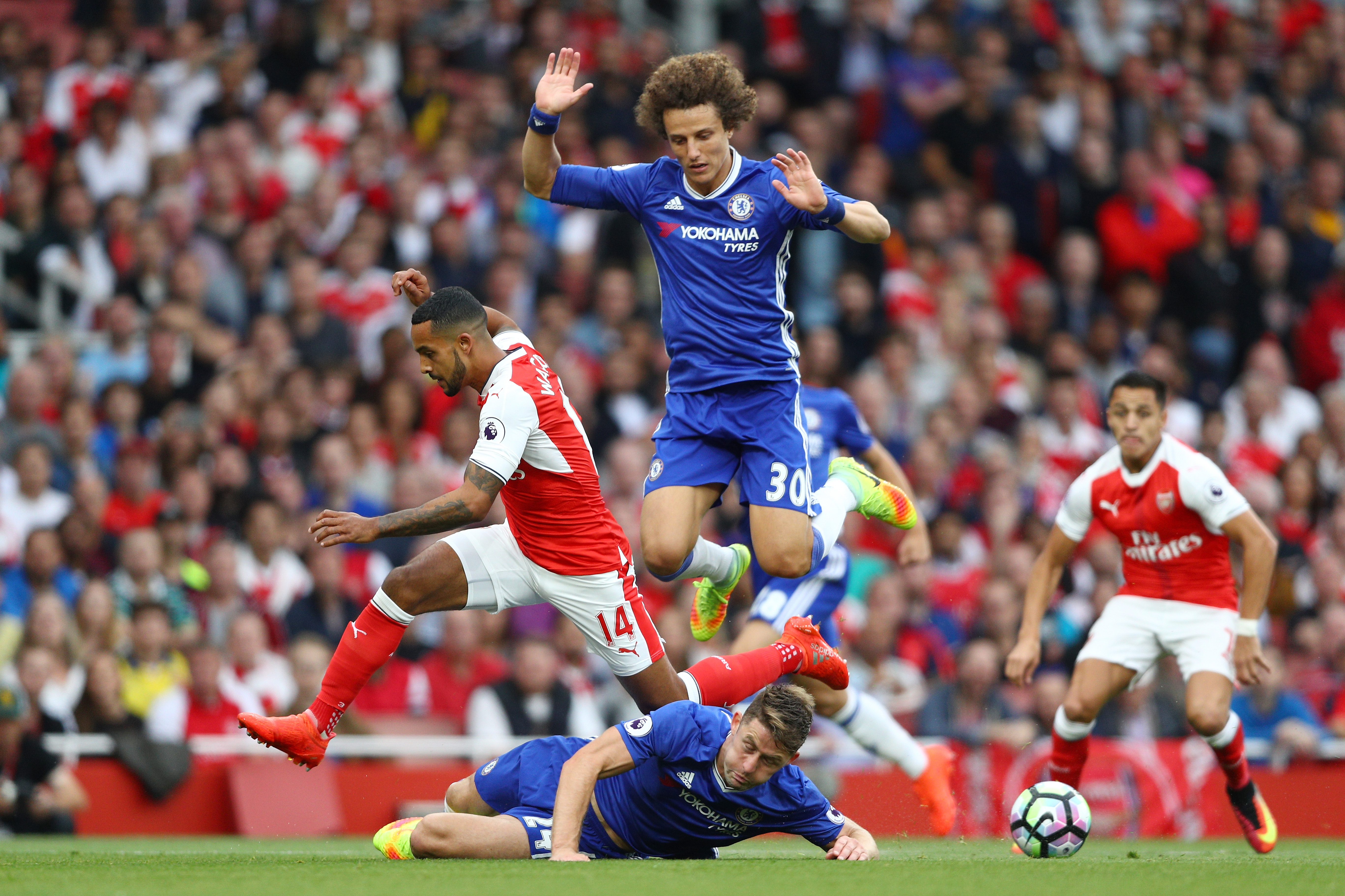 LONDON, ENGLAND - SEPTEMBER 24: Theo Walcott of Arsenal (L) is fouled by Gary Cahill of Chelsea (C) during the Premier League match between Arsenal and Chelsea at the Emirates Stadium on September 24, 2016 in London, England. (Photo by Paul Gilham/Getty Images)
