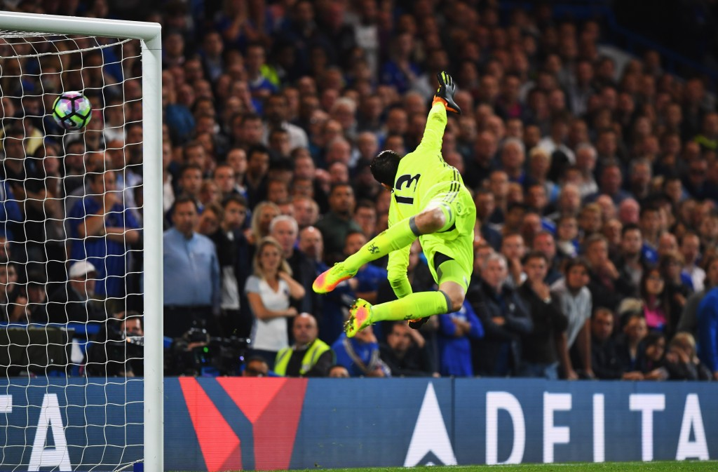 LONDON, ENGLAND - SEPTEMBER 16: Thibaut Courtois of Chelsea dives in vain as Jordan Henderson of Liverpool scores their second goal during the Premier League match between Chelsea and Liverpool at Stamford Bridge on September 16, 2016 in London, England. (Photo by Shaun Botterill/Getty Images)