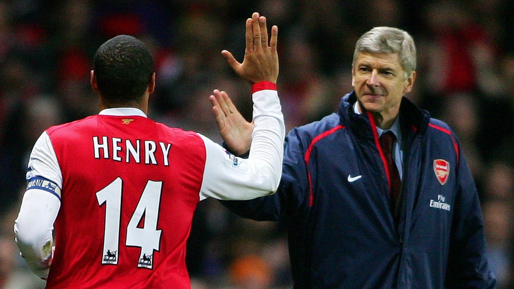 Arsenal's Captain, Frenchman Thierry Henry (L) celebrates with countryman manager Arsene Wenger (R) after scoring from a penalty shot during their Premiership match against Charlton at home to Arsenal, 02 January 2006. (Photo by Carl de Souza/AFP/Getty Images)