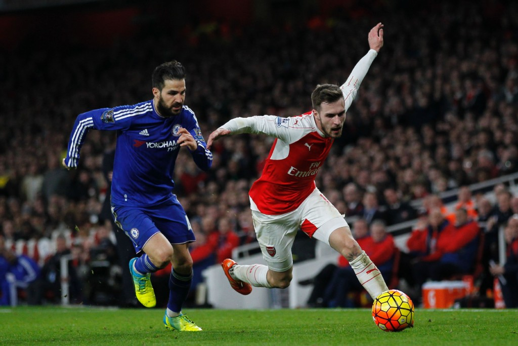 Chelsea's Spanish midfielder Cesc Fabregas (L) vies with Arsenal's Welsh midfielder Aaron Ramsey during the English Premier League football match between Arsenal and Chelsea at the Emirates Stadium in London on January 24, 2016. AFP PHOTO / IKIMAGES Could Ramsey return to England to join Chelsea, like former Arsenal captain Cesc Fabregas once did? (Photo by IKIMAGES/AFP/Getty Images)