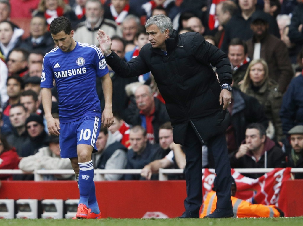 Chelsea's Portuguese manager Jose Mourinho (R) speaks with Chelsea's Belgian midfielder Eden Hazard during the English Premier League football match between Arsenal and Chelsea at the Emirates Stadium in London on April 26, 2015. AFP PHOTO / ADRIAN DENNIS RESTRICTED TO EDITORIAL USE. No use with unauthorized audio, video, data, fixture lists, club/league logos or live services. Online in-match use limited to 45 images, no video emulation. No use in betting, games or single club/league/player publications. (Photo credit should read ADRIAN DENNIS/AFP/Getty Images)