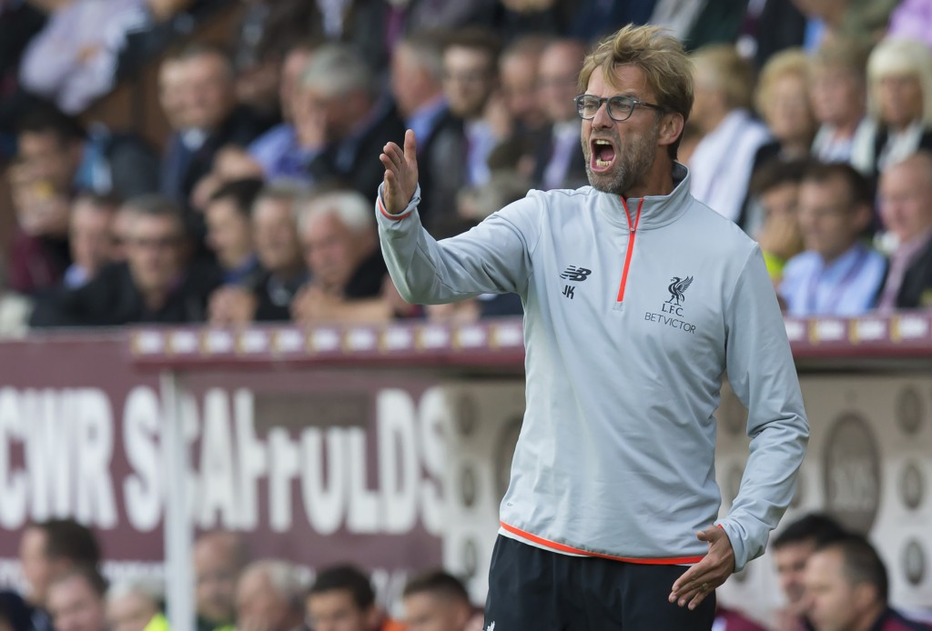 Liverpool's German manager Jurgen Klopp gestures on the touchline during the English Premier League football match between Burnley and Liverpool at Turf Moor in Burnley, north west England on August 20, 2016. / AFP / JON SUPER / RESTRICTED TO EDITORIAL USE. No use with unauthorized audio, video, data, fixture lists, club/league logos or 'live' services. Online in-match use limited to 75 images, no video emulation. No use in betting, games or single club/league/player publications. / (Photo credit should read JON SUPER/AFP/Getty Images)