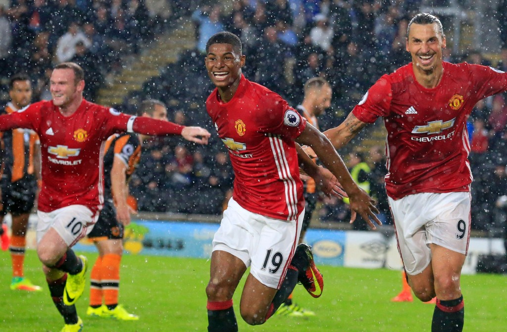 The experienced duo would provide Rashford with the education to thrive as a forward for years to come for both club and country. (Picture Courtesy - AFP/Getty Images)