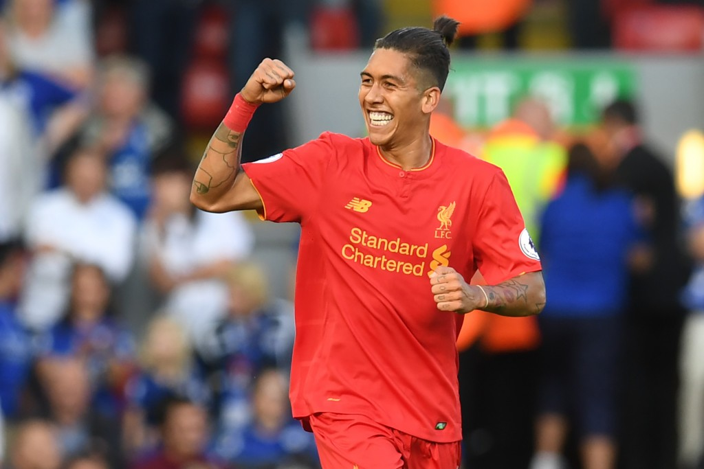 Liverpool's Brazilian midfielder Roberto Firmino celebrates after scoring the opening goal of the English Premier League football match between Liverpool and Leicester City at Anfield in Liverpool, north west England on September 10, 2016. / AFP / Paul ELLIS / RESTRICTED TO EDITORIAL USE. No use with unauthorized audio, video, data, fixture lists, club/league logos or 'live' services. Online in-match use limited to 75 images, no video emulation. No use in betting, games or single club/league/player publications. / (Photo credit should read PAUL ELLIS/AFP/Getty Images)