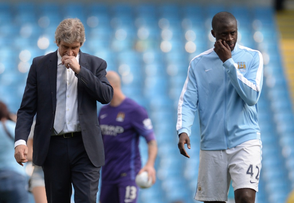 Manchester City's Chilean manager Manuel Pellegrini (L) and Manchester City's Ivorian midfielder and captain Yaya Toure walk on the pitch after the English Premier League football match between Manchester City and Arsenal at the Etihad Stadium in Manchester, north west England, on May 8, 2016. / AFP / OLI SCARFF / RESTRICTED TO EDITORIAL USE. No use with unauthorized audio, video, data, fixture lists, club/league logos or 'live' services. Online in-match use limited to 75 images, no video emulation. No use in betting, games or single club/league/player publications. / (Photo credit should read OLI SCARFF/AFP/Getty Images)