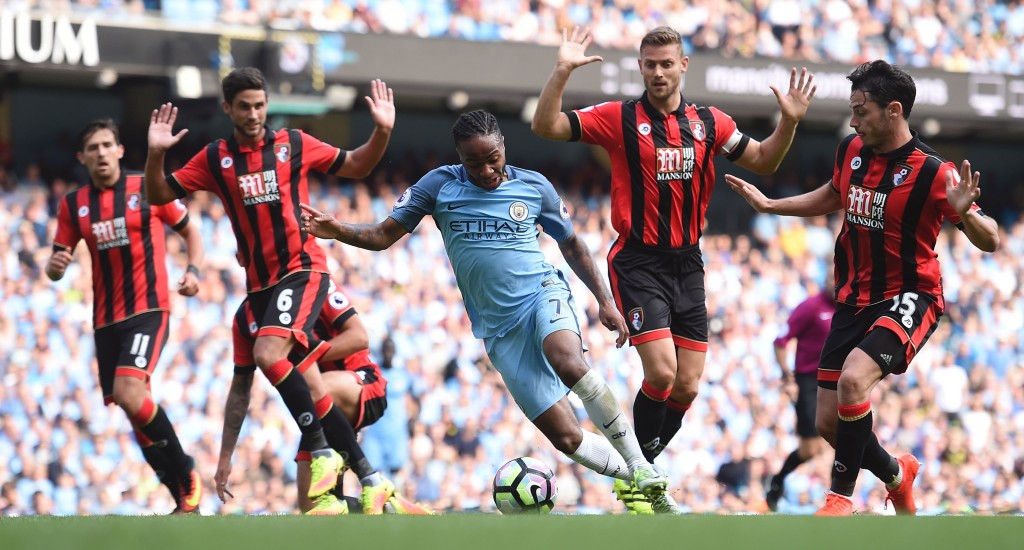 Manchester City's English midfielder Raheem Sterling (C) wriggles past Bournemouth's South African-born English midfielder Andrew Surman (2L) and Bournemouth's English defender Simon Francis (2R) during the English Premier League football match between Manchester City and Bournemouth at the Etihad Stadium in Manchester, north west England, on September 17, 2016. (Photo by Paul Ellis/AFP/Getty Images)