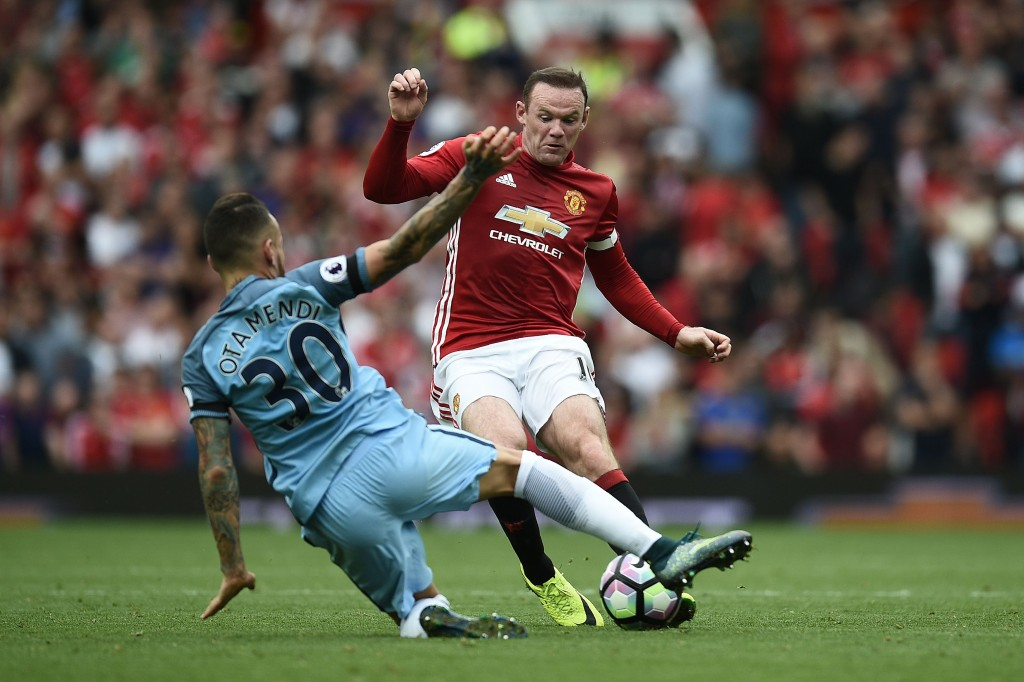 Manchester United's English striker Wayne Rooney (R) vies with Manchester City's Argentinian defender Nicolas Otamendi during the English Premier League football match between Manchester United and Manchester City at Old Trafford in Manchester, north west England, on September 10, 2016. / AFP / Oli SCARFF / RESTRICTED TO EDITORIAL USE. No use with unauthorized audio, video, data, fixture lists, club/league logos or 'live' services. Online in-match use limited to 75 images, no video emulation. No use in betting, games or single club/league/player publications. / (Photo credit should read OLI SCARFF/AFP/Getty Images)