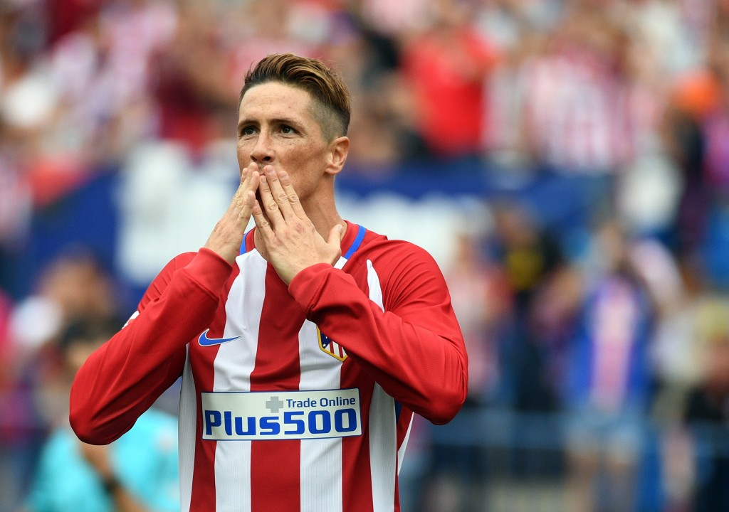 Atletico Madrid's forward Fernando Torres celebrates after scoring a penalty during the Spanish league football match Club Atletico de Madrid vs Real Sporting de Gijon at the Vicente Calderon stadium in Madrid on September 17, 2016. / AFP / GERARD JULIEN (Photo credit should read GERARD JULIEN/AFP/Getty Images)