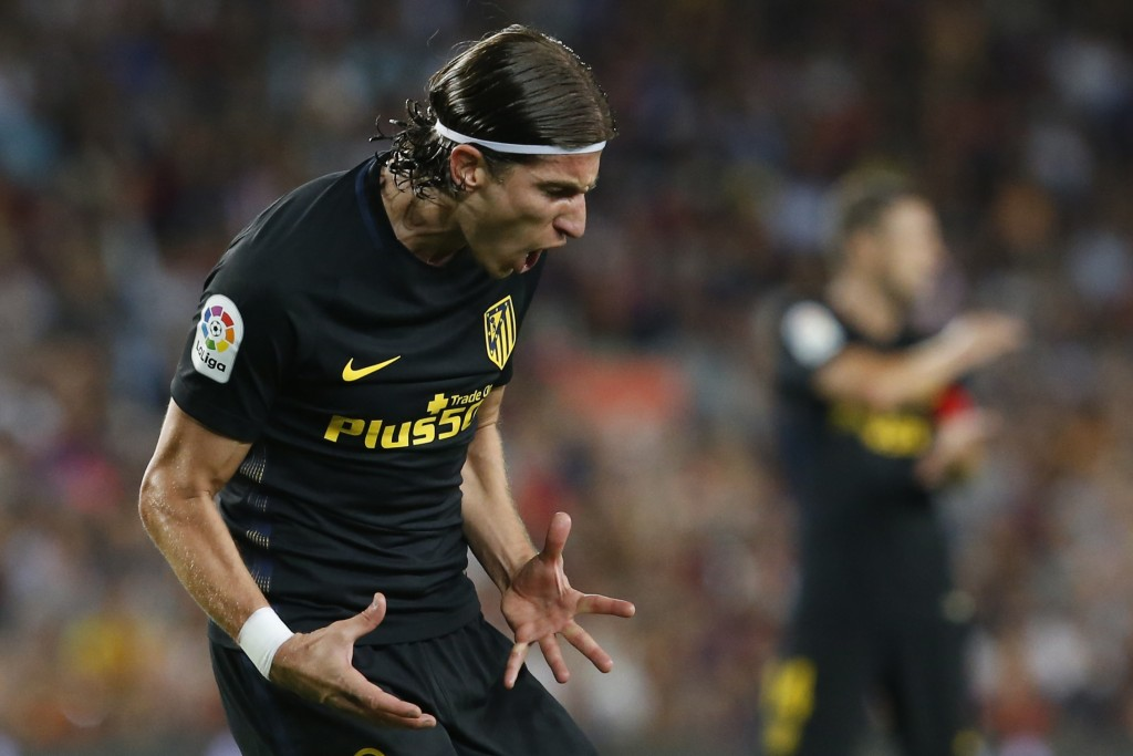 Atletico Madrid's Brazilian defender Filipe Luis shouts after missing a goal opportunity during the Spanish league football match FC Barcelona vs Atletico de Madrid at the Camp Nou stadium in Barcelona on September 21, 2016. / AFP / PAU BARRENA (Photo credit should read PAU BARRENA/AFP/Getty Images)