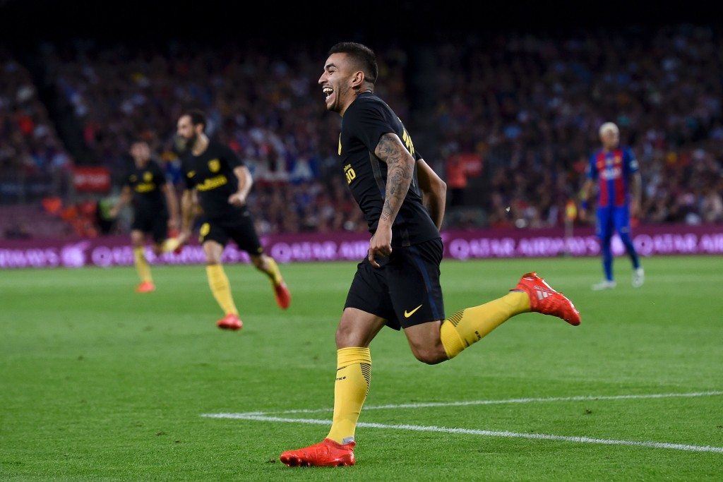 Atletico Madrid's Argentinian forward Angel Correa celebrates his goal during the Spanish league football match FC Barcelona vs Atletico de Madrid at the Camp Nou stadium in Barcelona on September 21, 2016. / AFP / JOSEP LAGO (Photo credit should read JOSEP LAGO/AFP/Getty Images)