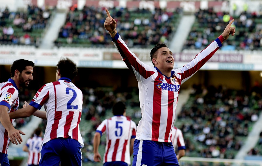 Atletico Madrid's Uruguayan defender Jose Maria Gimenez celebrates after scoring during the Spanish league football match Elche FC vs Club Atletico Madrid at the Martin Valero stadium in Valencia on December 6, 2014. (Photo credit should read JOSE JORDAN/AFP/Getty Images)