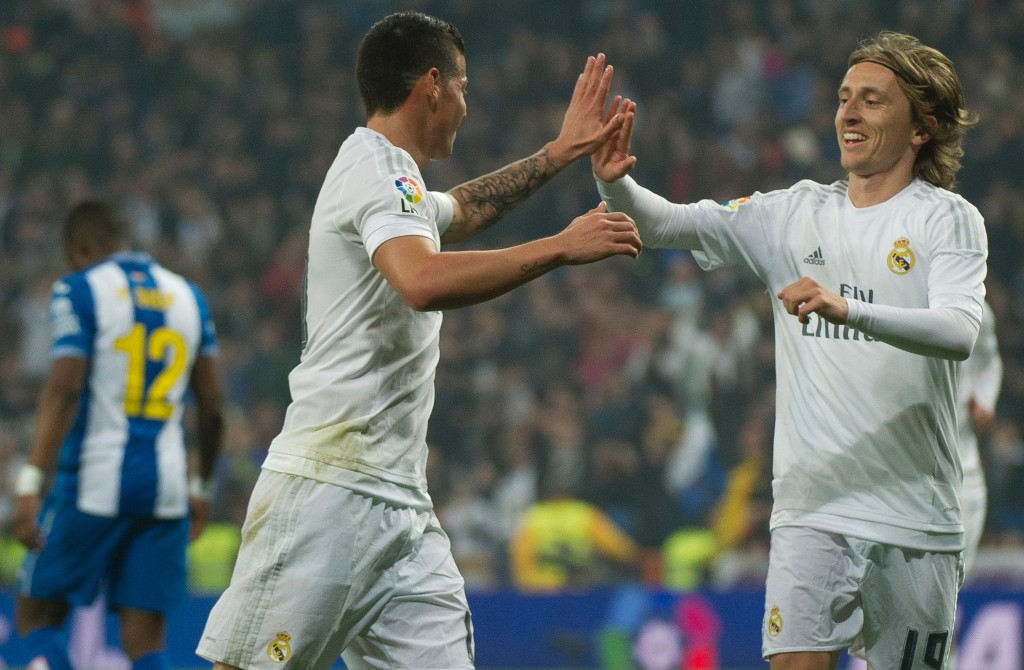 It is likely to be down to the duo of Modric and James Rodriguez to cover up for the absence of Ronaldo and Bale. (Picture Courtesy - AFP/Getty Images)