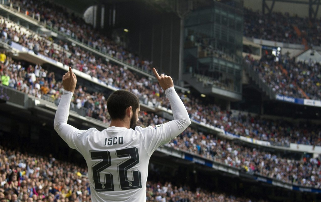 Real Madrid's midfielder Isco celebrates his goal during the Spanish league football match Real Madrid CF vs UD Las Palmas at the Santiago Bernabeu stadium in Madrid on October 31, 2015.(Photo by Curto de la Torre/AFP/Getty Images)