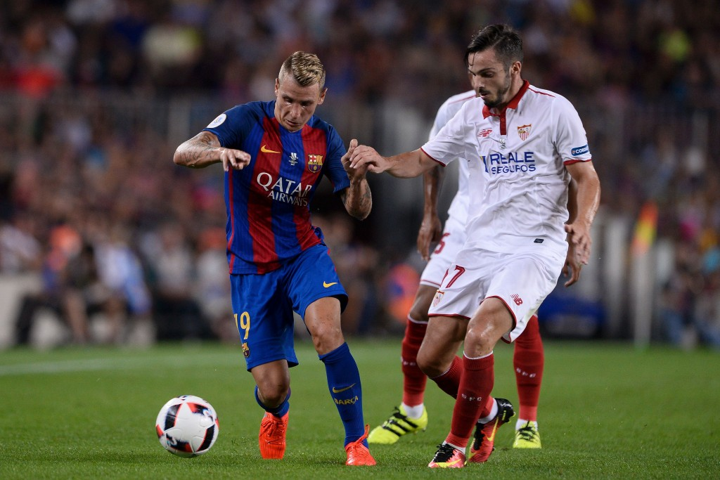 Barcelona's French defender Lucas Digne (L) vies with Sevilla's midfielder Pablo Sarabia during the second leg of the Spanish Supercup football match between FC Barcelona and Sevilla FC at the Camp Nou stadium in Barcelona on August 17, 2016. / AFP / JOSEP LAGO (Photo credit should read JOSEP LAGO/AFP/Getty Images)