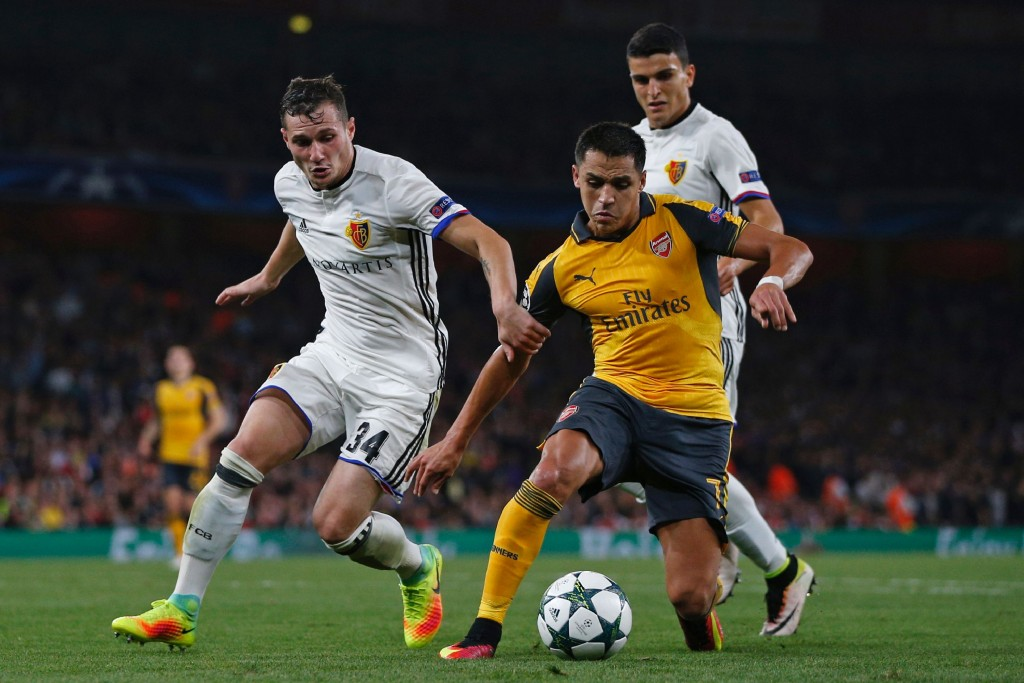 Arsenal's Chilean striker Alexis Sanchez (R) vies with Basel's Albanian midfielder Taulant Xhaka (L) during the UEFA Champions League Group A football match between Arsenal and FC Basel at The Emirates Stadium in London on September 28, 2016. Arsenal won the game 2-0. (Photo by Adrian Dennis/AFP/Getty Images)