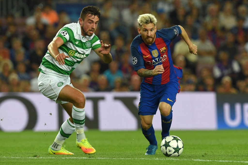 Barcelona's Argentinian forward Lionel Messi (R) vies with Celtic's Irish defender Eoghan O'Connell during the UEFA Champions League football match FC Barcelona vs Celtic FC at the Camp Nou stadium in Barcelona on September 13, 2016. (Photo by Lluis Gene/AFP/Getty Images)