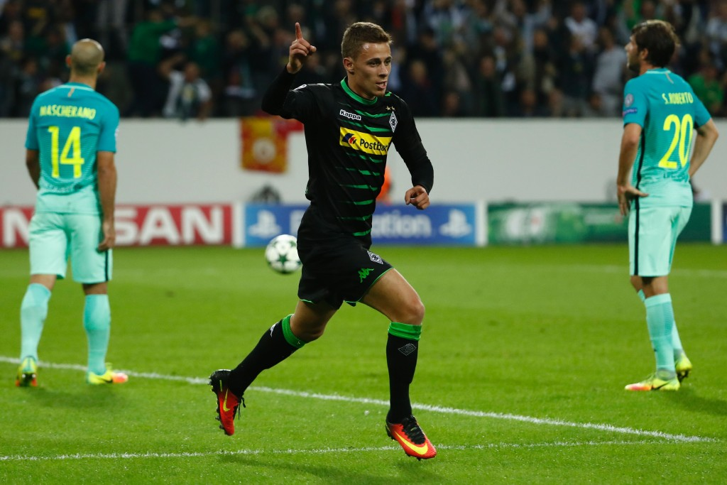 Moenchengladbach's Belgian midfielder Thorgan Hazard (C) celebrates after scoring the opening goal during the UEFA Champions League first-leg group C football match between Borussia Moenchengladbach and FC Barcelona at the Borussia Park in Moenchengladbach, western Germany on September 28, 2016. / AFP / Odd ANDERSEN (Photo credit should read ODD ANDERSEN/AFP/Getty Images)