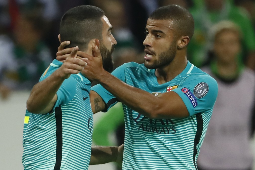 Barcelona's Turkish midfielder Arda Turan (L) celebrate after scoring the 1-1 equalizer with Barcelona's Brazilian midfielder Rafinha during the UEFA Champions League first-leg group C football match between Borussia Moenchengladbach and FC Barcelona at the Borussia Park in Moenchengladbach, western Germany on September 28, 2016. / AFP / Odd ANDERSEN (Photo credit should read ODD ANDERSEN/AFP/Getty Images)