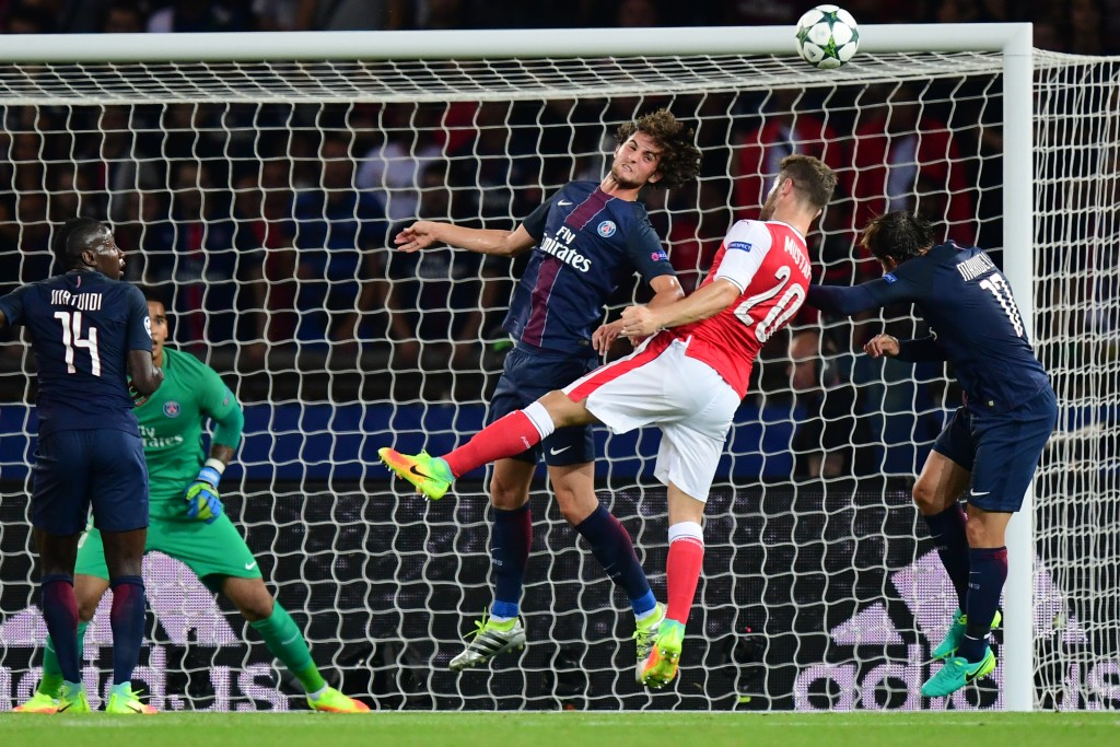 Paris Saint-Germain's French midfielder Adrien Rabiot (3rdR) vies with Arsenal's German defender Shkodran Mustafi (2ndR), next to Paris Saint-Germain's Brazilian defender Maxwell (R), and Paris Saint-Germain's French midfielder Blaise Matuidi (L) during the UEFA Champions League Group A football match between Paris-Saint-Germain vs Arsenal FC, on September 13, 2016 at the Parc des Princes stadium in Paris. AFP PHOTO / FRANCK FIFE / AFP / FRANCK FIFE (Photo credit should read FRANCK FIFE/AFP/Getty Images)