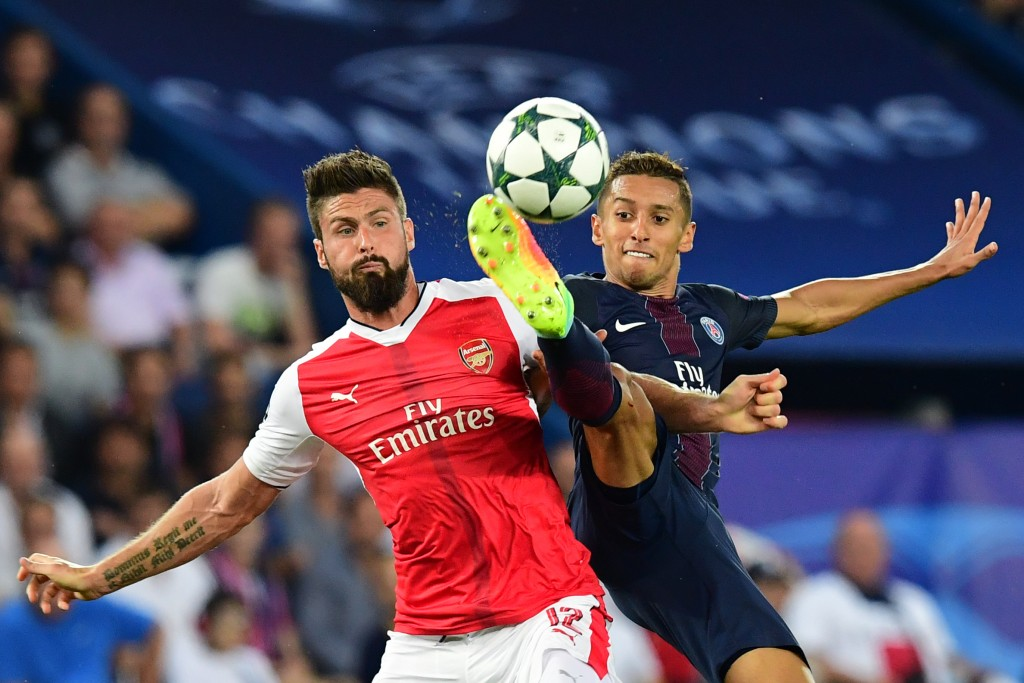 Arsenal's French forward Olivier Giroud (L) vies with Paris Saint-Germain's Brazilian defender Marquinhos during the UEFA Champions League Group A football match between Paris-Saint-Germain vs Arsenal FC, on September 13, 2016 at the Parc des Princes stadium in Paris. (Photo by Franck Fife/AFP/Getty Images)