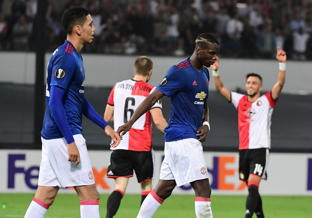 Manchester United's Paul Pogba (C) and Chris Smalling react after losing the UEFA Europa League football match between Feyenoord Rotterdam and Manchester United at the Feyenoord Stadium in Rotterdam on September 15, 2016. Feyenoord won the match 1-0. (Photo by Emmanuel Dunand/AFP/Getty Images)