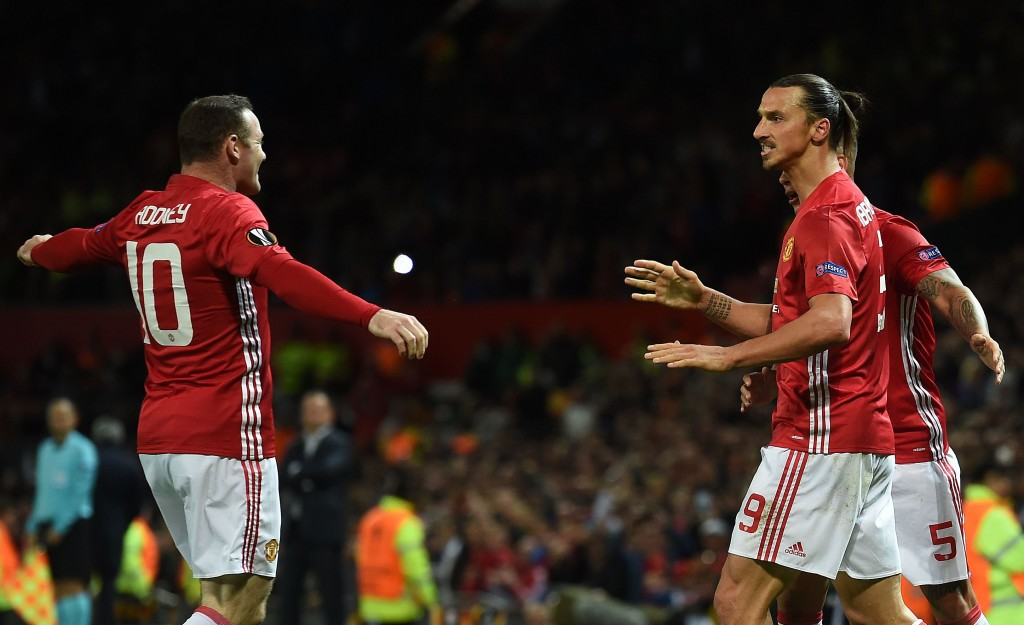 Manchester United's Swedish striker Zlatan Ibrahimovic (R) celebrates scoring his team's first goal with Manchester United's English striker Wayne Rooney (L) during the UEFA Europa League group A football match between Manchester United and Zorya Luhansk at Old Trafford stadium in Manchester, north-west England on September 29, 2016. / AFP / PAUL ELLIS (Photo credit should read PAUL ELLIS/AFP/Getty Images)