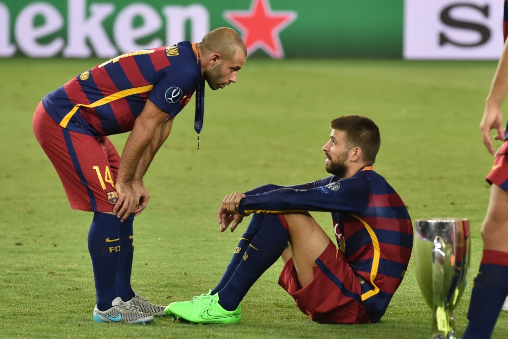 Barcelona's Spanish defender Gerard Pique and Barcelona's Argentinian defender Javier Mascherano (L) react after winning the UEFA Super Cup final football match between FC Barcelona and Sevilla FC on August 11, 2015 at the Boris Paichadze Dinamo Arena in Tbilisi. AFP PHOTO / KIRILL KUDRYAVTSEV (Photo credit should read KIRILL KUDRYAVTSEV/AFP/Getty Images)