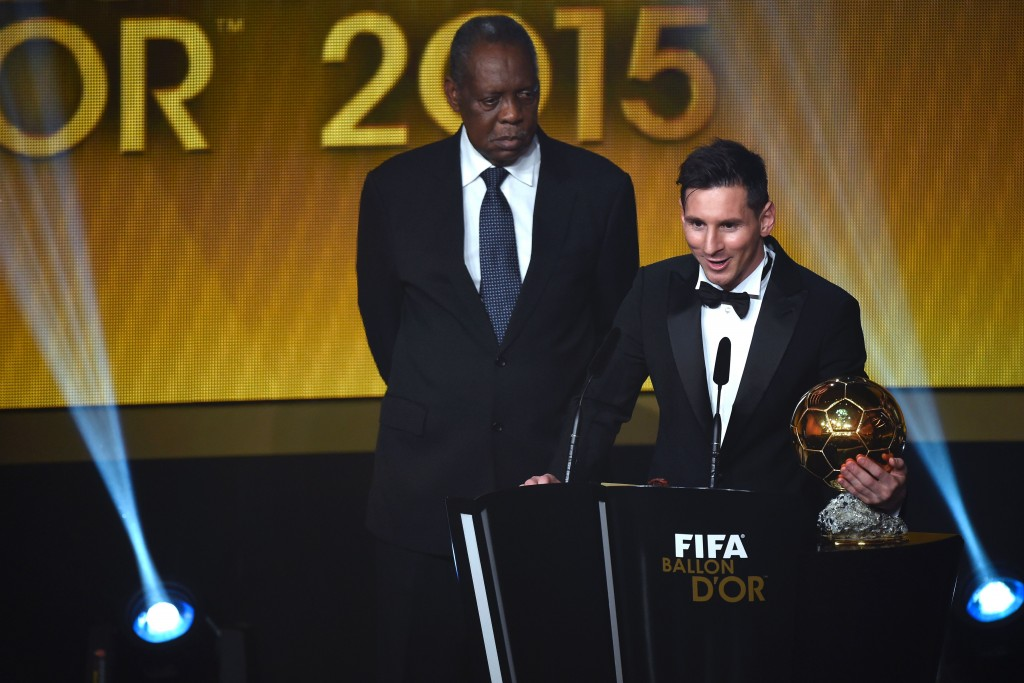 FC Barcelona and Argentina's forward Lionel Messi delivers a speech flanked by FIFA interim president Issa Hayatou (L) after receiving the 2015 FIFA Ballon dOr award for player of the year during the 2015 FIFA Ballon d'Or award ceremony at the Kongresshaus in Zurich on January 11, 2016. AFP PHOTO / OLIVIER MORIN / AFP / OLIVIER MORIN (Photo credit should read OLIVIER MORIN/AFP/Getty Images)