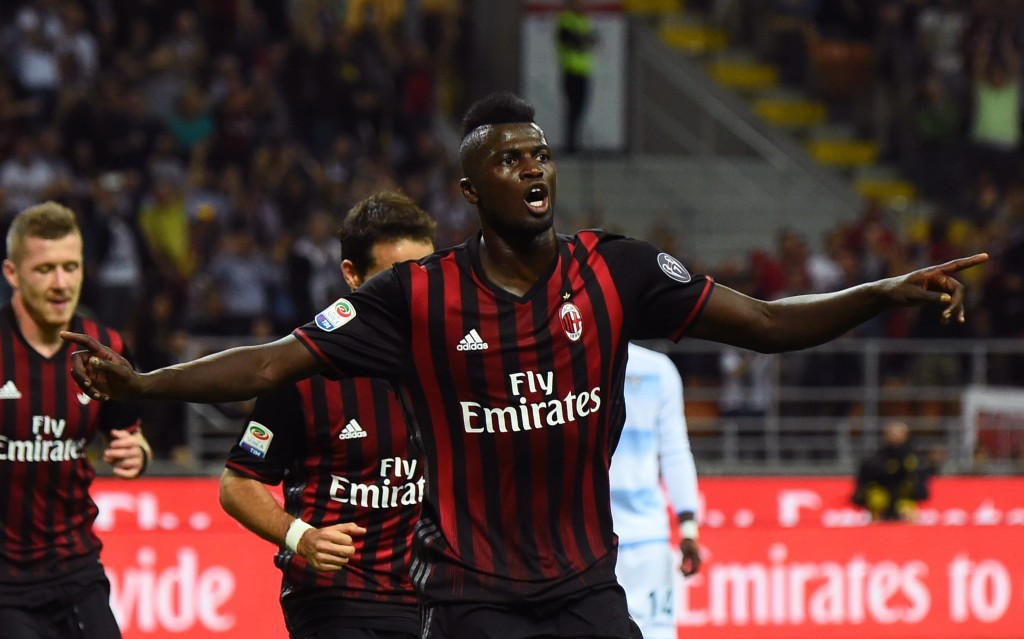AC Milan's French forward from France Mbaye Niang celebrates after scoring a goal during the Italian Serie A football match between AC Milan and SS Lazio at the San Siro Stadium in Milan, on September 20, 2016. (Photo by Giuseppe Cacace/AFP/Getty Images)