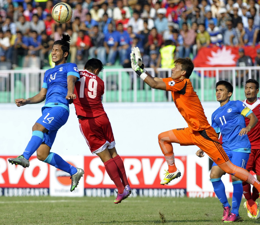 Nepalese goalkeeper Kiran Kumar Limbu (R) breaks out for a save as Indian football player Arata Izumi (L) attempts a goal during their SAFF Championship football match in Kathmandu on September 5, 2013. Nepal won 2-1. AFP PHOTO / Prakash MATHEMA (Photo credit should read PRAKASH MATHEMA/AFP/Getty Images)