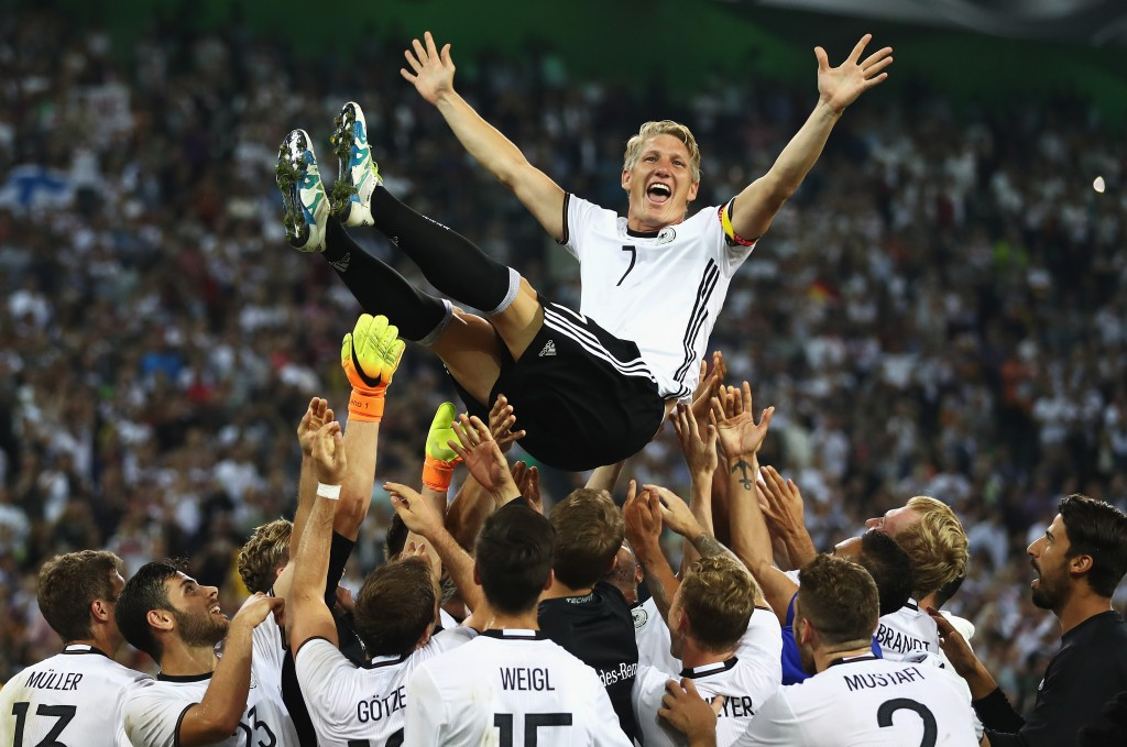 MOENCHENGLADBACH, GERMANY - AUGUST 31: Bastian Schweinsteiger of Germany is thrown in to the air by team mates after his last international match during the International Friendly match between Germany and Finland at Borussia-Park on August 31, 2016 in Moenchengladbach, Germany. (Photo by Lars Baron/Bongarts/Getty Images)