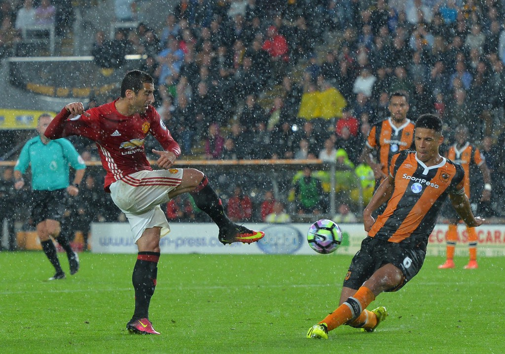 HULL, ENGLAND - AUGUST 27: Henrikh Mkhitaryan of Manchester United has his shot blocked by Curtis Davis of Hull City during the Premier League match between Manchester United FC and Hull City FC at KC Stadium on August 27, 2016 in Hull, England. (Photo by Mark Runnacles/Getty Images)