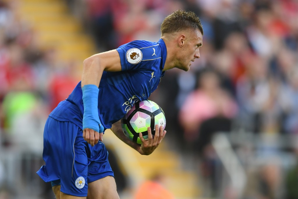 LIVERPOOL, ENGLAND - SEPTEMBER 10: Jamie Vardy of Leicester City grabs the ball after scoring his sides first goal during the Premier League match between Liverpool and Leicester City at Anfield on September 10, 2016 in Liverpool, England. (Photo by Michael Regan/Getty Images)