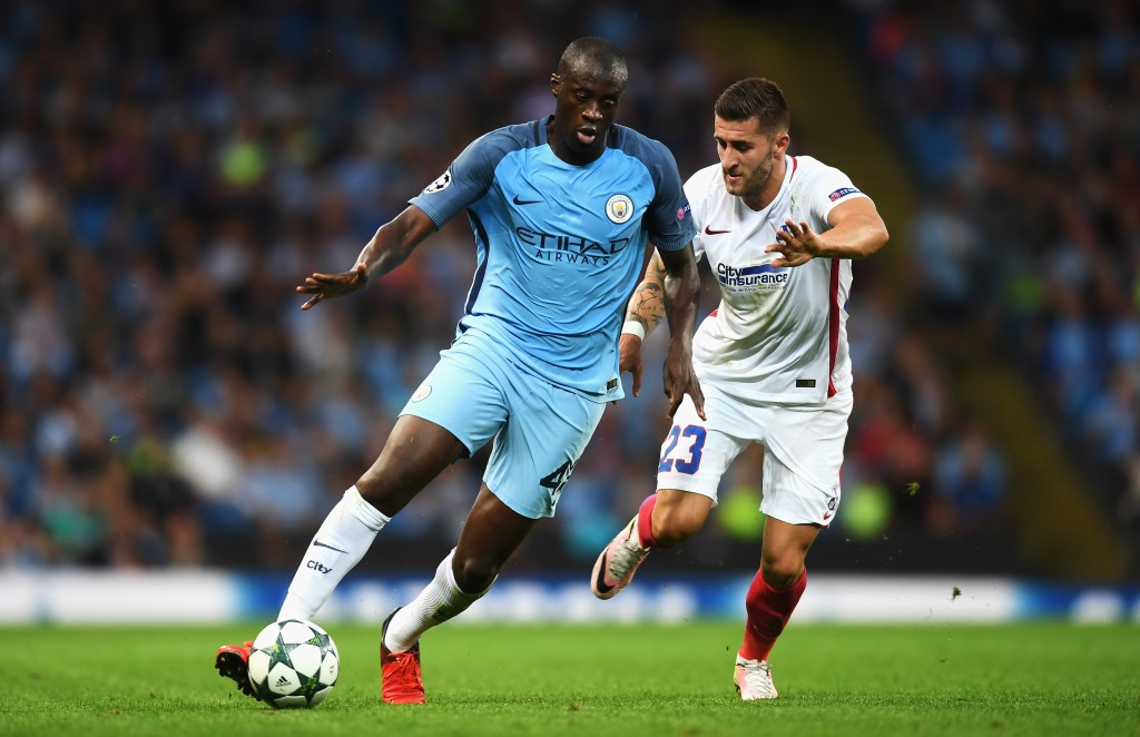 MANCHESTER, ENGLAND - AUGUST 24: Yaya Toure of Manchester City is closed down by Ovidiu Popescu of Steaua Bucharest during the UEFA Champions League Play-off Second Leg match between Manchester City and Steaua Bucharest at Etihad Stadium on August 24, 2016 in Manchester, England. (Photo by Michael Regan/Getty Images)