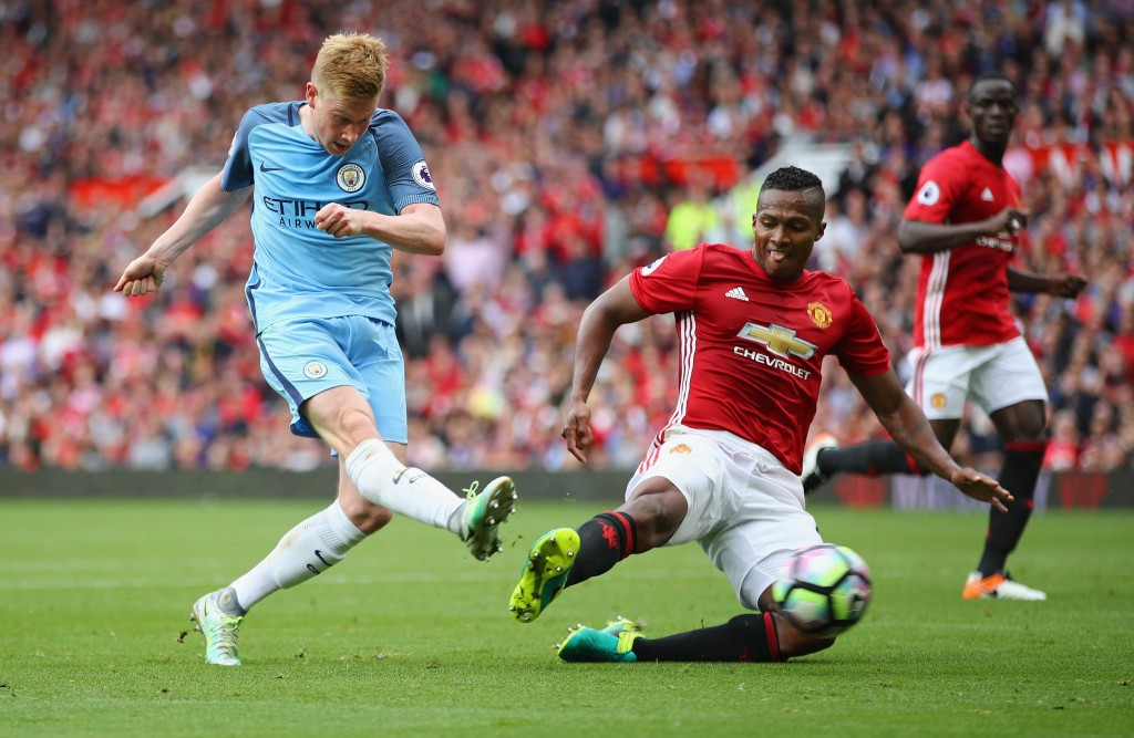 MANCHESTER, ENGLAND - SEPTEMBER 10: Kevin De Bruyne of Manchester City shoots past Antonio Valencia of Manchester United during the Premier League match between Manchester United and Manchester City at Old Trafford on September 10, 2016 in Manchester, England. (Photo by Clive Brunskill/Getty Images)