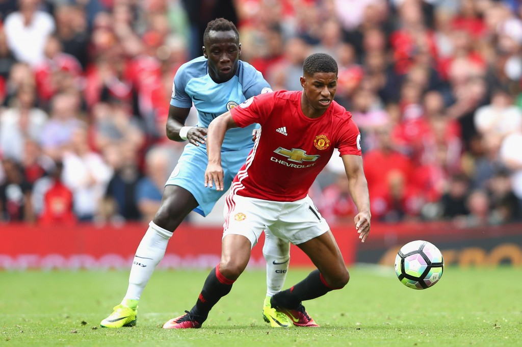MANCHESTER, ENGLAND - SEPTEMBER 10: Marcus Rashford of Manchester United is challenged by Bacary Sagna of Manchester City during the Premier League match between Manchester United and Manchester City at Old Trafford on September 10, 2016 in Manchester, England. (Photo by Clive Brunskill/Getty Images)