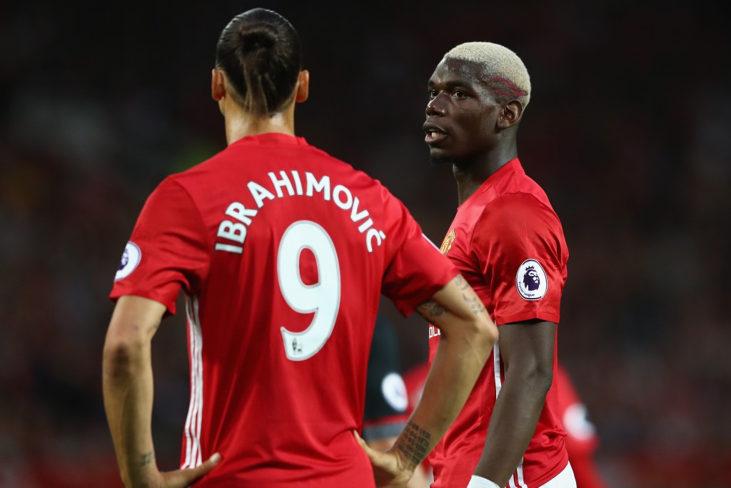 MANCHESTER, ENGLAND - AUGUST 19: Paul Pogba (R) of Manchester United looks towards Zlatan Ibbrahimovic during the Premier League match between Manchester United and Southampton at Old Trafford on August 19, 2016 in Manchester, England. (Photo by Michael Steele/Getty Images)