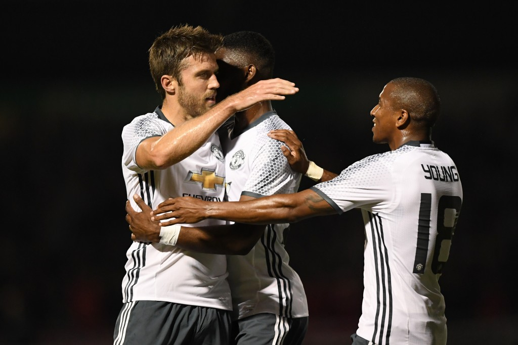 NORTHAMPTON, ENGLAND - SEPTEMBER 21: Michael Carrick of Manchester United celebrates scoring his sides first goal with team mates during the EFL Cup Third Round match between Northampton Town and Manchester United at Sixfields on September 21, 2016 in Northampton, England. (Photo by Shaun Botterill/Getty Images)