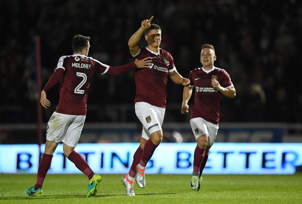 NORTHAMPTON, ENGLAND - SEPTEMBER 21: Alex Revell of Northampton Town celebrates scoring his sides first goal with team mates during the EFL Cup Third Round match between Northampton Town and Manchester United at Sixfields on September 21, 2016 in Northampton, England. (Photo by Shaun Botterill/Getty Images)