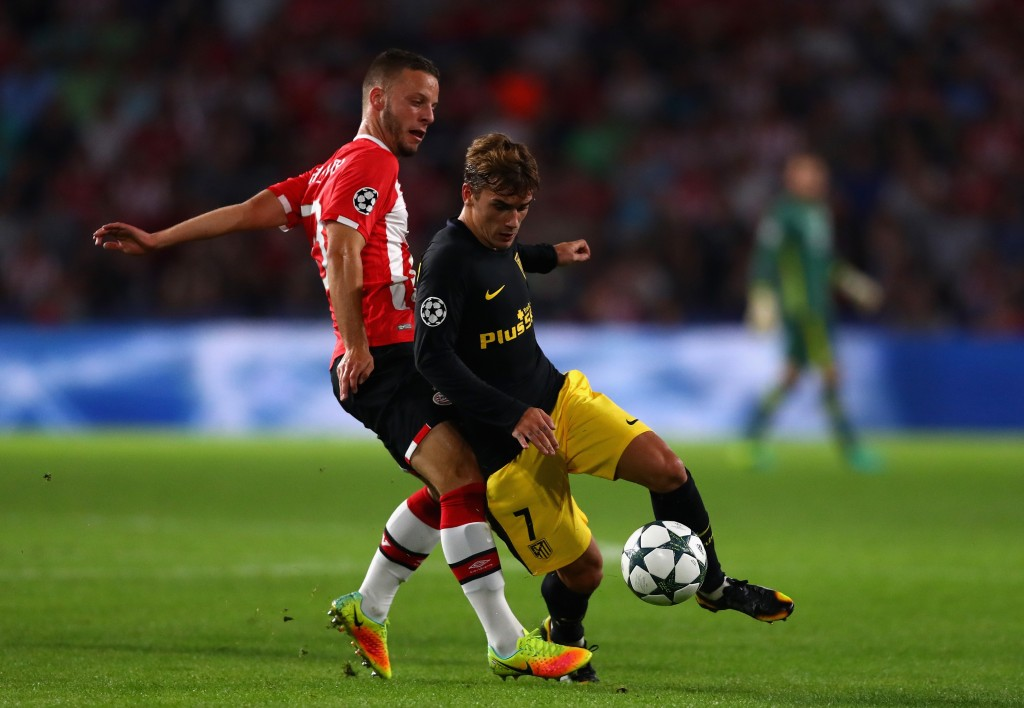 EINDHOVEN, NETHERLANDS - SEPTEMBER 13: Bart Ramselaar of PSV Eindhoven and Antoine Griezmann of Atletico Madrid in action during the UEFA Champions League Group D match between PSV Eindhoven and Club Atletico de Madrid at Philips Stadion on September 13, 2016 in Eindhoven, Netherlands . (Photo by Dean Mouhtaropoulos/Getty Images)