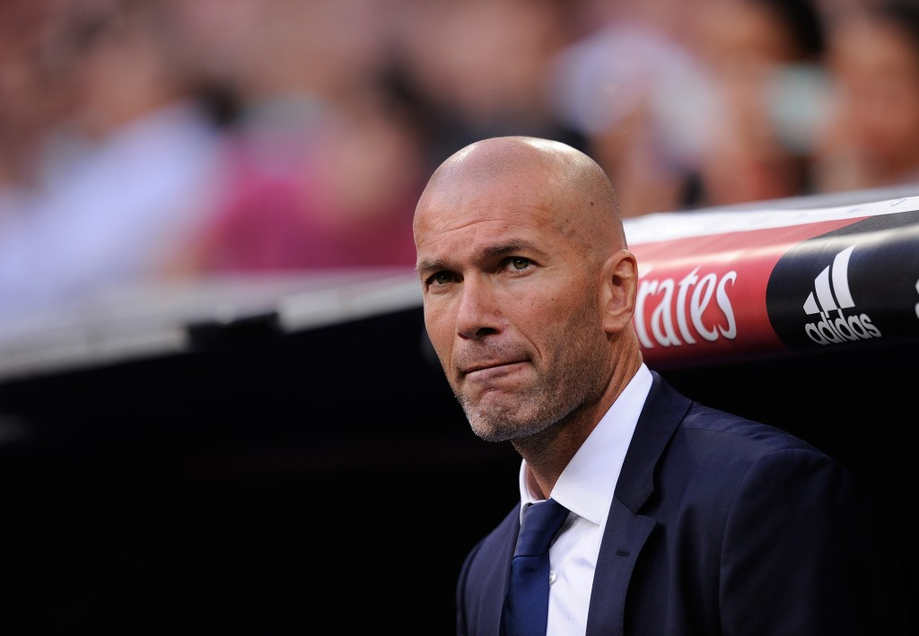 Manager Zinedine Zidane of Real Madrid looks on before the La Liga match between Real Madrid CF and RC Celta de Vigo at Estadio Santiago Bernabeu on August 27, 2016 in Madrid, Spain. (Photo by Denis Doyle/Getty Images)