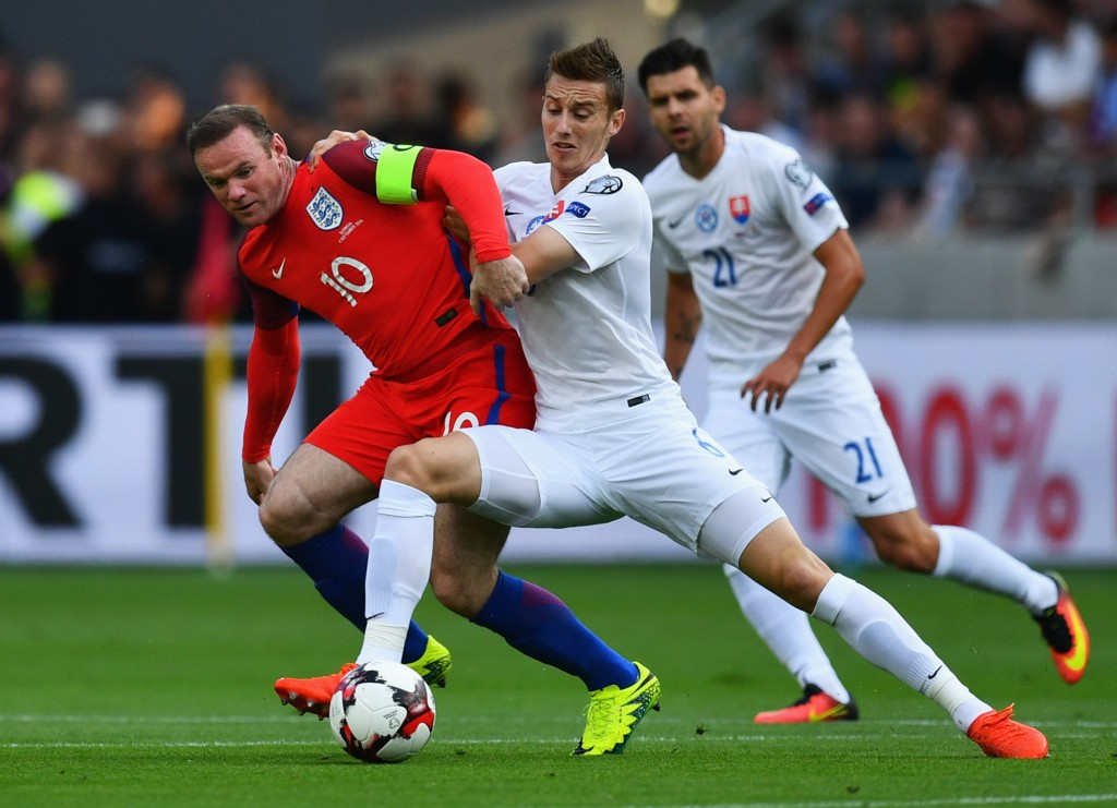 TRNAVA, SLOVAKIA - SEPTEMBER 04: Wayne Rooney of England battles with Jan Gregus of Slovakia during the 2018 FIFA World Cup Group F qualifying match between Slovakia and England at City Arena on September 4, 2016 in Trnava, Slovakia. (Photo by Dan Mullan/Getty Images)