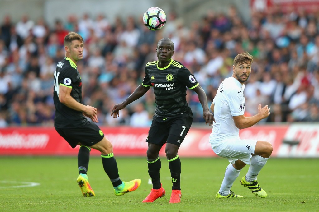 SWANSEA, WALES - SEPTEMBER 11: (L-R) Gary Cahill and N'Golo Kante of Chelsea and Fernando Llorente of Swansea City watch the ball during the Premier League match between Swansea City and Chelsea at Liberty Stadium on September 11, 2016 in Swansea, Wales. (Photo by Alex Livesey/Getty Images)