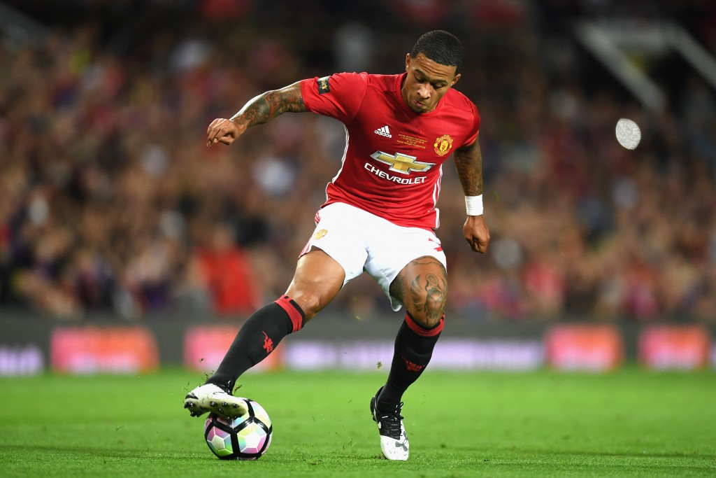 MANCHESTER, ENGLAND - AUGUST 03: Memphis Depay of Manchester United in action during the Wayne Rooney Testimonial match between Manchester United and Everton at Old Trafford on August 3, 2016 in Manchester, England. (Photo by Michael Regan/Getty Images)